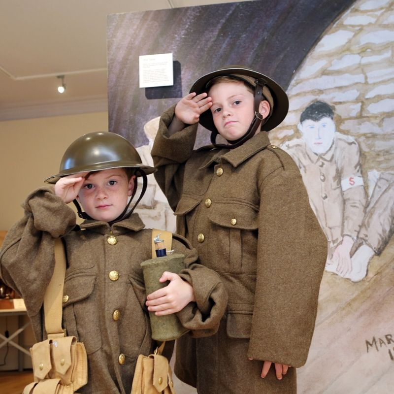 Two Boys Dressed As Soldiers