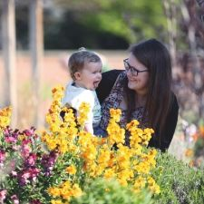 Mother and child walking amongst the flower beds in the Walled Garden