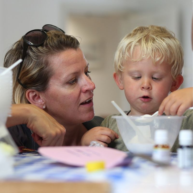 Boy And Mother Making Cakes