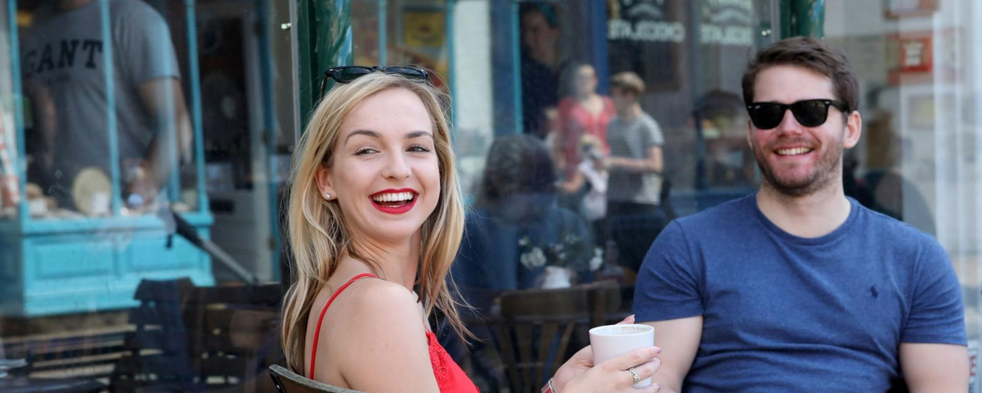 Couple Enjoying Tea And Coffee Outside Of The Tea Room On The Victorian Street