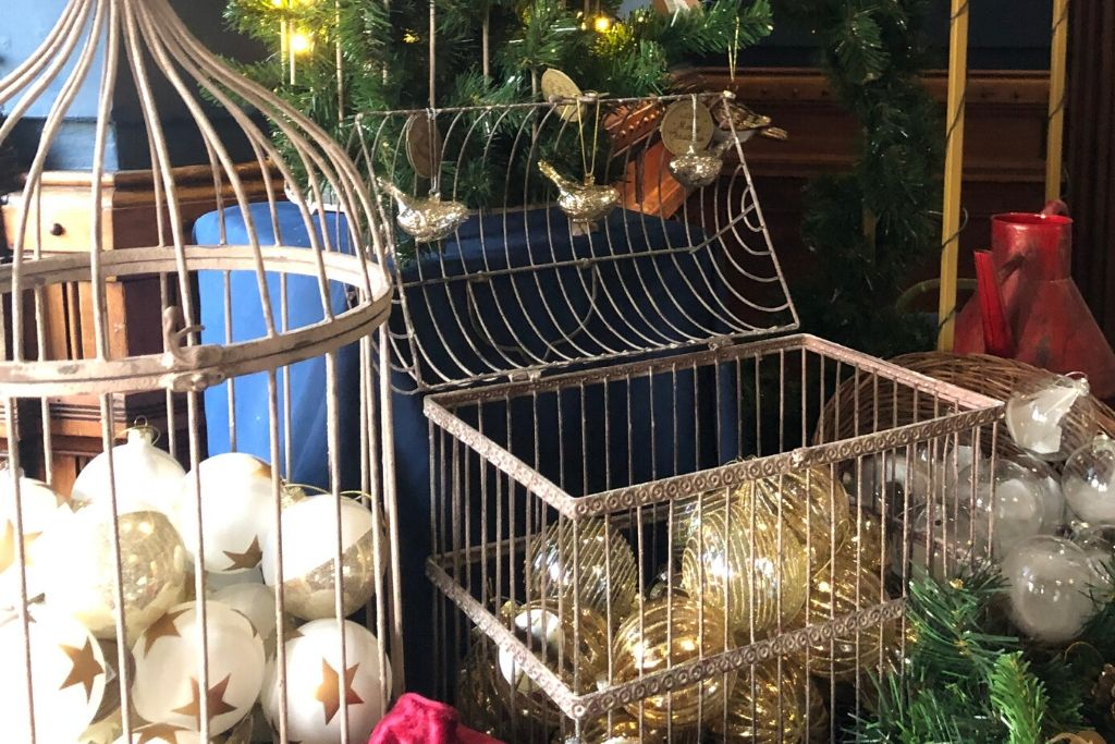 Gold And White Baubles In A Cage
