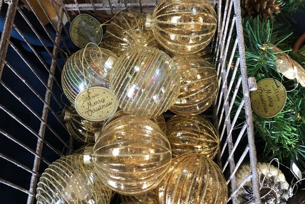 Gold Baubles In A Bird Cage