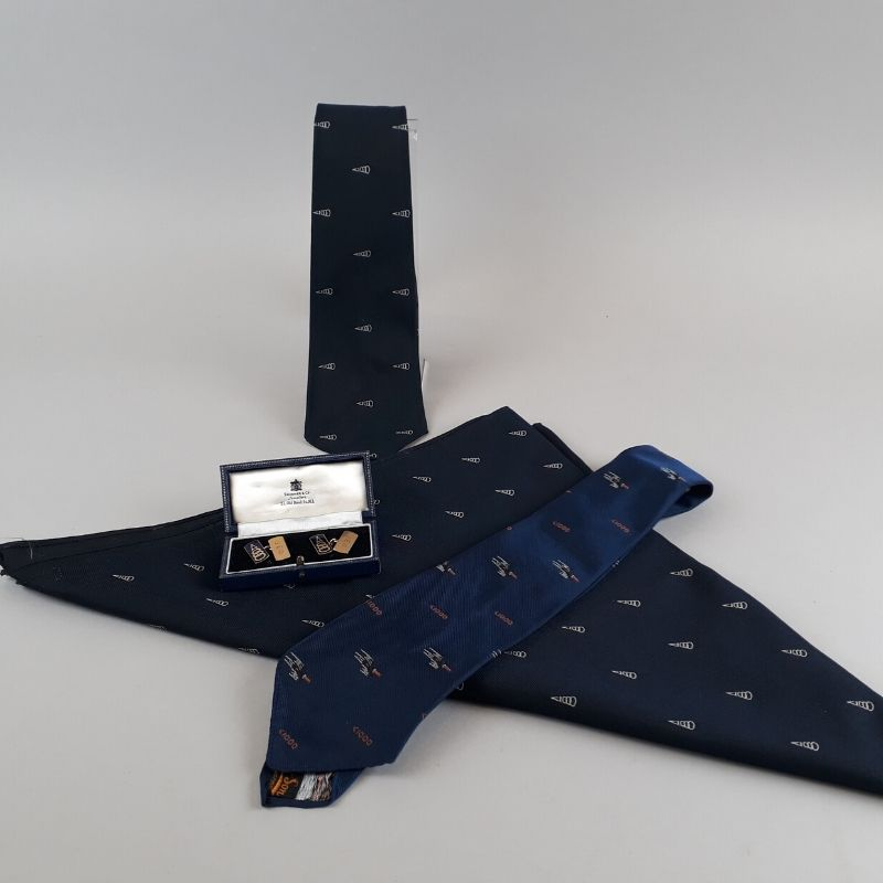 the items that Jean was given when she joined the 1000 Mph Club. There are two ties, a scarf and a set of cufflinks. They all include the club logo and the cufflinks are also inscribed with Jean's initials - JEO.